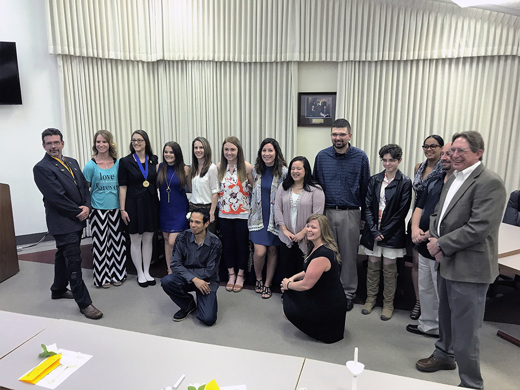 PTK members, officers, and advisors at Clovis Community College during the 2017 induction ceremony